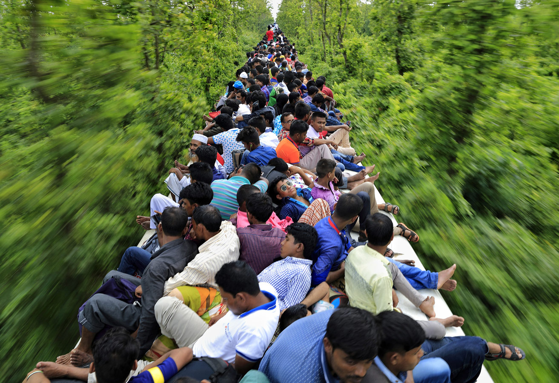 Поездка на переполненном поезде, © Нур Ахмед Гелал, Дакка, Бангладеш, Финалист категории «Спонтанные моменты», профессионал, Фотоконкурс экстремальных путешествий «Мир в фокусе» — World In Focus