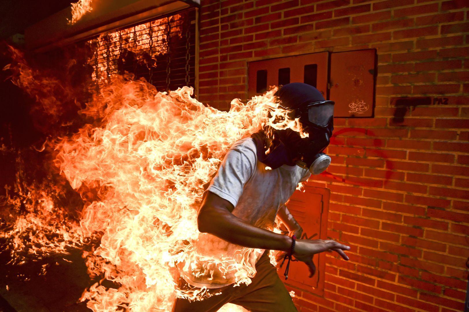 Венесуэльский кризис, © Роналду Щеидт, Венесуэла, Фотография года, Фотоконкурс World Press Photo